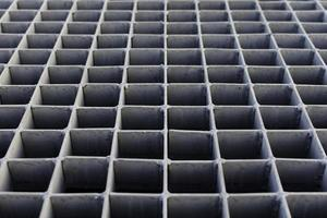 The gray metal grating on the street drain. photo
