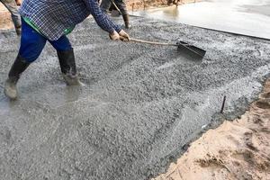 Person smoothing cement