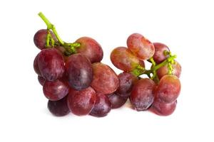 Ripe red grape with bunch isolated on white background. studio shot isolated.