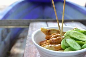Chicken and cucumbers photo