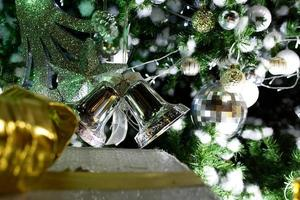 Bell and accessories on Christmas tree background.