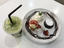 Chocolate lava cake with a drink photo