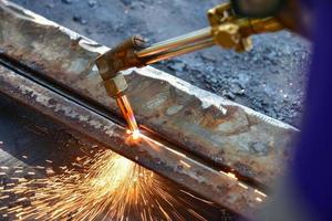 Worker cutting metal plate photo