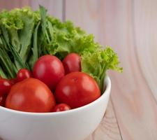 Bowl of tomatoes and spring onions photo