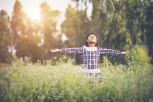 Little girl raising her hands in the fresh air