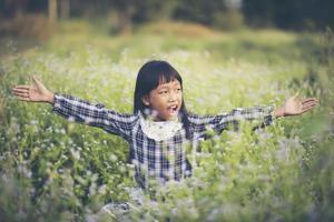 Happy girl sitting in a meadow