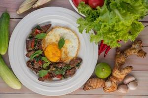 Stir fried basil liver with fried egg