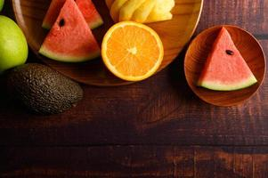 Colorful watermelon, pineapple, oranges with avocado and apples
