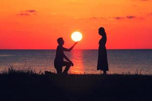 Silhouette of a couple at sunset photo