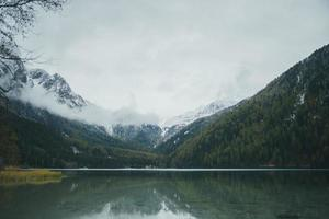 Mountain and lake with cloudy sky