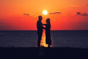 Two person at sunset photo