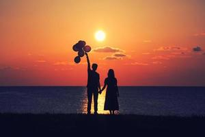 Two people at sunset photo