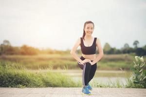 Healthy young woman warming up outdoors for training