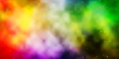 Fondo de vector multicolor claro con estrellas pequeñas y grandes.