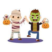 niños pequeños en disfraces de halloween vector