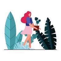 mujer joven levantando plantas en el jardín