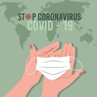 detener la pandemia de coronavirus con las manos sosteniendo la máscara vector