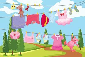 linda ropa infantil colgada en una línea en la escena al aire libre vector