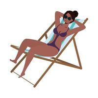 beautiful black woman wearing swimsuit and seated in beach chair