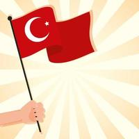mano ondeando la bandera de pavo