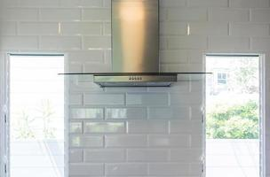 close up modern of kitchen hood made from stainless for exhaust dust and smoke, Kitchen Wall Mount Range Hood with touch control. Cooking Hoods. Kitchen Appliances photo