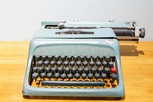 Vintage blue typewriter photo