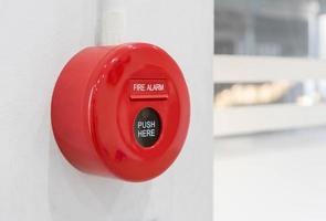 fire alarm mounted on cement wall for warning and security system photo