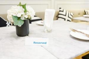 Reserved plate on a dinner table in a restaurant with elegant table setting