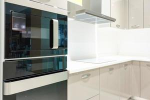 Beige and white kitchen photo