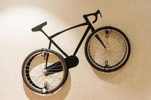 Modern living room with wooden stylish bicycle hanging on wall