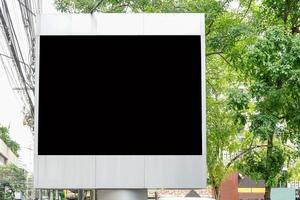Billboard with empty screen for outdoor advertising, against blue cloudy sky