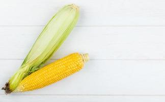 Top view of uncooked and cooked corn photo