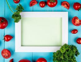 Picture frame surrounded by tomatoes and lettuce