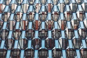 London, UK, 2020 - Architectural building with glass windows photo