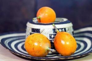 Granadilla, fruit on top of sombrero vueltiao photo
