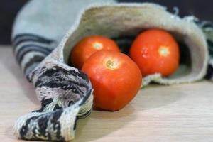 fresh tomatoes in backpack photo