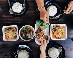 People eating Thai food