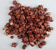 top view of chocolate popcorn on white background