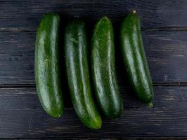 Top view of cucumbers on a wooden background