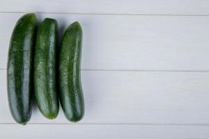 Top view of cucumbers on wooden background