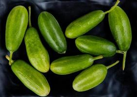 top view of cucumbers on black background