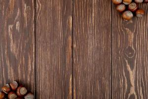 Top view of hazelnuts isolated on wooden background