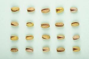top view of pistachio nuts isolated on a white background