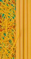 top view of macaronis as spaghetti and bucatini on blue background