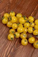 Tomatoes on wooden background photo