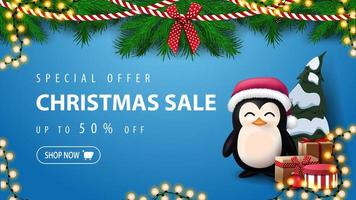Special offer, Christmas sale, up to 50 off, blue discount banner with wreath of Christmas tree branches and penguin in Santa Claus hat with presents near the wall