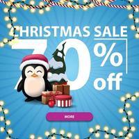 Christmas sale, up to 70 off, blue discount banner with Large numbers, button, garland and penguin in Santa Claus hat with presents