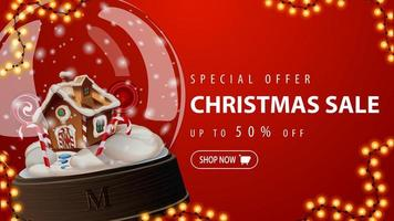Special offer, Christmas sale, up to 50 off, red discount banner with large snow globe with Christmas gingerbread house inside vector