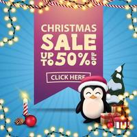 Christmas sale, up to 50 off, square blue discount banner with large pink ribbon with offer, garlands, candle and penguin in Santa Claus hat with presents