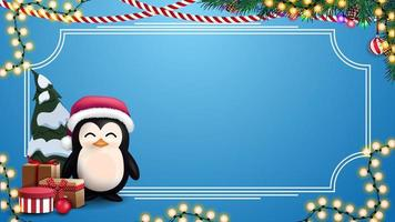 Christmas blue blank template for your arts with place for text, garlands, frame and penguin in Santa Claus hat with presents